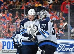EDMONTON, AB - OCTOBER 9: Dmitry Kulikov #5 and Connor Hellebuyck #37 of the Winnipeg Jets celebrate after winning the game against the Edmonton Oilers on October 9, 2017 at Rogers Place in Edmonton, Alberta, Canada. (Photo by Andy Devlin/NHLI via Getty Images)