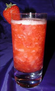 Adult Strawberry Pineapple Punch Cocktail. A yummy, refreshing summertime cocktail. The fresh fruit makes it to die for. (It would be great also if frozen or crush ice until slushy.)