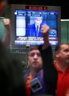 George W. Bush was the worst President in American history. A trader in the DJIA stock index futures pit at the Chicago Board of Trade signals offers as a monitor above the trading floor broadcasts President George W. President Bush addressing the nation about financial crisis Oct. 10, 2008 in Chicago, Illinois.