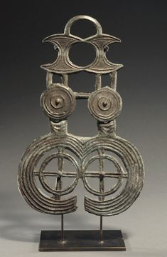 CENTRAL EUROPEAN BRONZE AGE BRONZE PENDANT  Made in four sections.  11th-10th Century BC