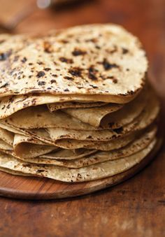 Thinner and chewier than paratha or naan, these earthy Indian flatbreads are made with whole durum wheat flour, called atta in Hindi. See the recipe »