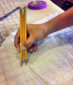 Use three pencils tied together to add a seam allowance to a pattern.