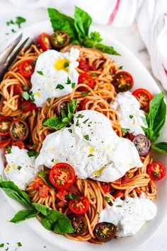 20 minute, crazy easy yet super snazzy spaghetti dish with the ultimate cheese garnish; creamy burrata.   aberdeenskitchen.com #spaghetti #tomato #basil #sauce #burrata #pasta #simple #quick #20minutes #vegetarian #dinner #recipe