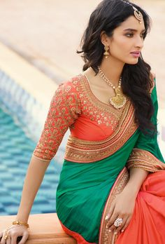 Featuring orange designer saree with golden zari embroidery on skirt , top and it comes with beautiful dupatta with embroidery on pallu border. BLOUSE: Silk and