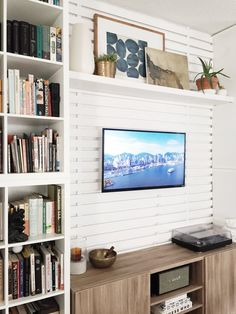 EASY DIY Slat wall with no nails! Use velcro to create a slat wall making this a non-permanant solution for your home or apartment. This is also a great solution for hiding TV cords. Living Room Storage, Wall Storage, Storage Ideas, Hide Tv Cords, Hallway Shelf, Entertainment Wall, Slat Wall, Room Organization, Being A Landlord