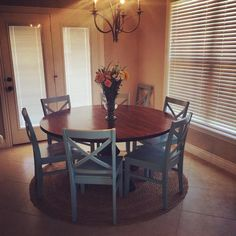 """60"""" Round Pedestal Table stained in Kona with a Semi-Gloss Sheen."""