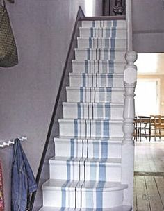 If you are decorating your beach house or just want to add a sea-inspired touch to your interior, a nautical staircase is an ideal variant – not too into Painted Staircases, Painted Stairs, Wooden Stairs, Painted Floors, Stair Makeover, Easy Home Decor, Beach Cottages, Beach House Decor, Coastal Living