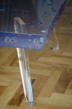 Acrylic coffee table filled with blue thistles