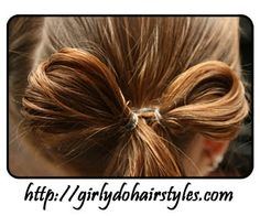 Natural hair bows... Only I would pull the hair at the bottom up and make a middle section to the bow... But I like it still