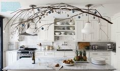 Love the idea of having real branches throughout the house, and decorating them just enhances them.