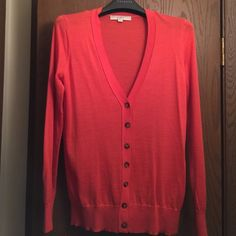 NWOT! Orange Cardigan Sweater NWOT! Orange Cardigan Sweater. Never worn. Sweaters Cardigans