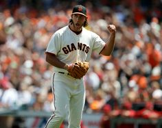 San Francisco Giants starting pitcher Madison Bumgarner (40) celebrates the final out of the top of the sixth inning on a throw to first by San Francisco Giants' Pablo Sandoval (48) against the Arizona Diamondbacks at AT&T Park in San Francisco, Calif. on Sunday, July 13, 2014. ...