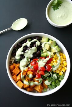 EASY sweet potato, black bean rice bowl with a southwestern flair! Topped with a creamy, flavorful cilantro-lime cashew sauce (vegan, gluten-free)