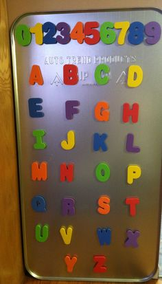 I made this for Carter! got an oil drip pan from Walmart & attached magnets to foam bath letters! so cute! :)