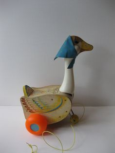 I called it my Duckie and I loved it. I pulled off the blue scarf when I was about four years old. Played with it forever, rolled it around the yard listening to it quack and laughing about it,