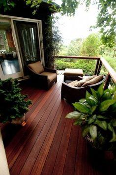 Love the dark wood and lush, serene view!!