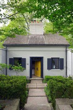 yellow door and navy shutters