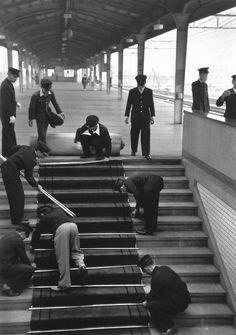 Preparations for the arrival of the Emperor/  Japan 1951.   Photo:  Werner Bischof