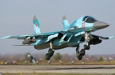 A Russian Air Force Sukhoi Su-34 takes to the air loaded with rocket pods under its wings.