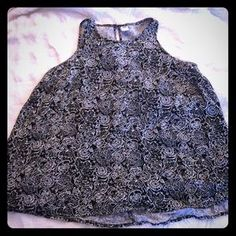 I just added this to my closet on Poshmark: Black and white flowing tank top. Price: $8 Size: L