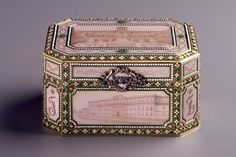 Music Box Fabergé (firm); Wigström, Henrik Immanuel (workmaster)  RUSSIA: Saint Petersburg  1907  Gold, enamel, diamonds, rubies  H. 1 7/8 in., W. 3 1/2 in., D. 2 1/2 in.  In 1907 Feliks and Nikolai Iusupov gave this music box to their parents, Prince Feliks and Princess Zinaida, as a twenty-fifth wedding anniversary present.