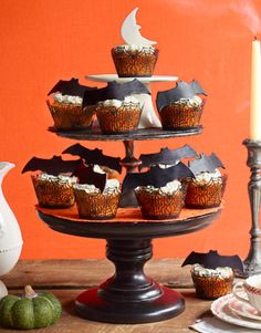Bat Cupcakes -- First roll out black fondant. Use cookie cutters to create bat shape, then let fondant dry overnight to stiffen. Just before serving, perch atop buttercream-frosted cupcakes.