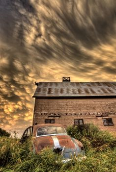 ˚Storm Clouds at the Barn with an Antique Car - Saskatchewan, Canada