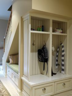 "love this with under-the stair bookshelves . . . but also like ""cubby hole"" wash rooms"