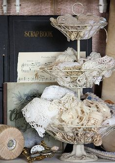 Lace storage on tier and vintage books draw you in...note black white contrast