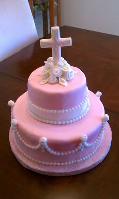 Baby's Baptism Cake This was for my baby girls baptism. It's strawberry cake with white chocolate buttercream frosting. MMF dyed...