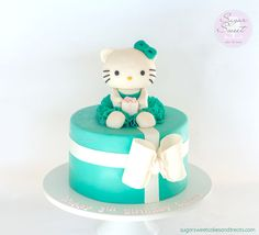 Modeling Chocolate Hello Kitty with a sparkly, ruffled dress and sparky present.  Bow is made out of fondant.