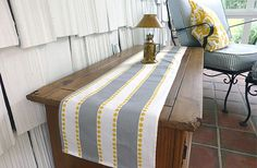 modern grey yellow and white table runner over vintage wood furniture