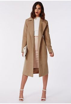 This lush camel coat will be your go to piece for the new season. The gorgeously elegant length and soft to the touch fabric make this a beautiful new season cover up. Style over all your new season outfits, from mini dresses to a skinny je...