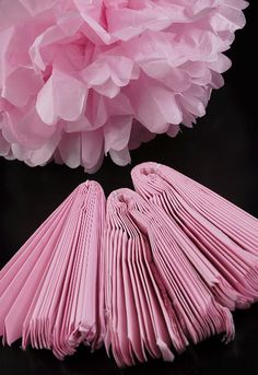 16 inch pink tissue paper flower balls  Set incl. 4 pom poms of same color; 2 w/ curved edge & 2 w/ straight edge.  Must be assembled. Hanger incl. Various colors available.  Set of 4 for $11.99.