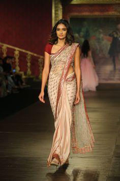 From Manish Malhotra to Rohit Bal, from pleatless to statement pallu sarees, discover the latest saree trends for Trendy Sarees, Stylish Sarees, Fancy Sarees, Latest Saree Trends, Latest Sarees, Indian Beauty Saree, Indian Sarees, Bengali Saree, Silk Sarees