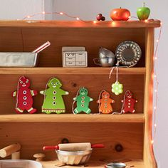 Roll out air-dry clay and press with gingerbread cookie cutters. Decorate with puffy paints, sequins, and rhinestones.