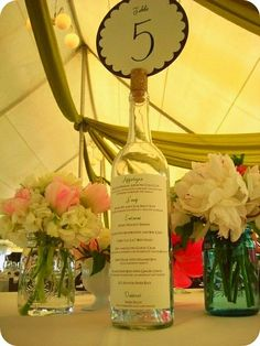 great way to combine table numbers and menu!  plus really creative!