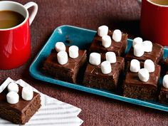 Hot Chocolate Brownies recipe from Food Network Kitchen via Food Network ~ These one-bowl brownies couldn't be easier to make, and adding leftover hot chocolate mix is the perfect way to make them extra special. Interested in a Mexican hot chocolate version? Just add 1 teaspoon ground cinnamon to the dry ingredients and sprinkle the top of each brownie with a pinch of chili powder.