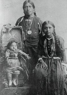 Pawnee young couple and child pose for a photo. The design on the cradleboard is unique to the Pawnee and relates to the myth of the morning star. To learn more about cradleboards, see here: http://traditionalnativehealing.com/native-american-cradleboards