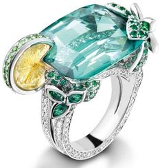 Piaget mojito ring.  18-carat white gold ring set with 182 brilliant-cut diamonds, 1 cushion-cut green tourmaline, 1 carved citrine, 16 round-cut tsavorites, 120 round-cut emeralds, and 8 marquise-cut emeralds. Via Diamonds in the Library.