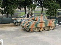 The Restored king tiger, and panther, at the saumur tank museum,france.