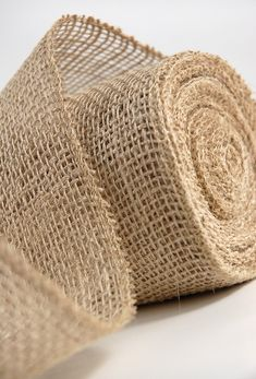 """Natural Jute Burlap Ribbon 4"""" wide 10 yds $5.00. Good to use for bridesmaids bouquets and other decorations."""