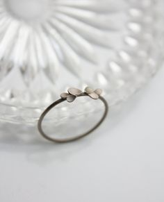 Zarter Verlobungsring aus Weißgold mit kleinen Blütenblättern / romantic engagement ring, white gold and little leaves by dkjewellery via DaWanda.com