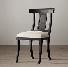 """$269 - $319 Our contemporary revival of the Greek Klismos chair – a classic since the 5th century B.C. – updates the elegant original with clean, contemporary proportions, a comfortably upholstered seat and a softly weathered finish.  Show product details... DIMENSIONS 20""""W x 23""""D x 35""""H"""