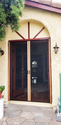 We installed Mahogany Wood Veneer Double Retractable Screen Doors on a set of French front doors in Simi Valley, California! For wooden front doors in need of Retractable Screens to match, call the Classic team! Visit www.chiproducts.com to see all of the many features we offer for you to customize your Retractable Screens, or call (866) 567-0400 for a free estimate! Retractable Screen Door, Pull Bar, Wooden Front Doors, Simi Valley, Screen Doors, Wood Veneer, French Doors, Oversized Mirror