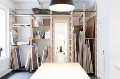 Practical use of space to store paper, layouts and canvases