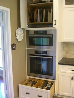 wall oven/micro cabinet - like the pan storage above & below #WallOvens