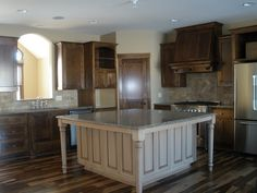 This custom LDK kitchen features Cambria countertops, Andean Pecan wood floor, Birch cabinets, Glazed enameled island, Jenn-Air appliances, and tile backsplash.