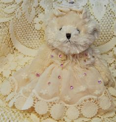 "Liberty Victorian Teddy Bear Approx 9"" has pink rhinestone earrings and bracelets, clothes do not come off, clothing: tulle, organza, lace, embellished with satin roses and rhinestones"