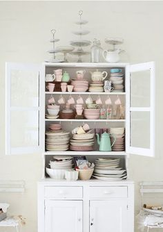 I dream of a collection of mismatched vintage dishes like this - no flowery patterns, just clean cozy colors and lots of cake/dessert pedestals. Perfect for all of the tea parties